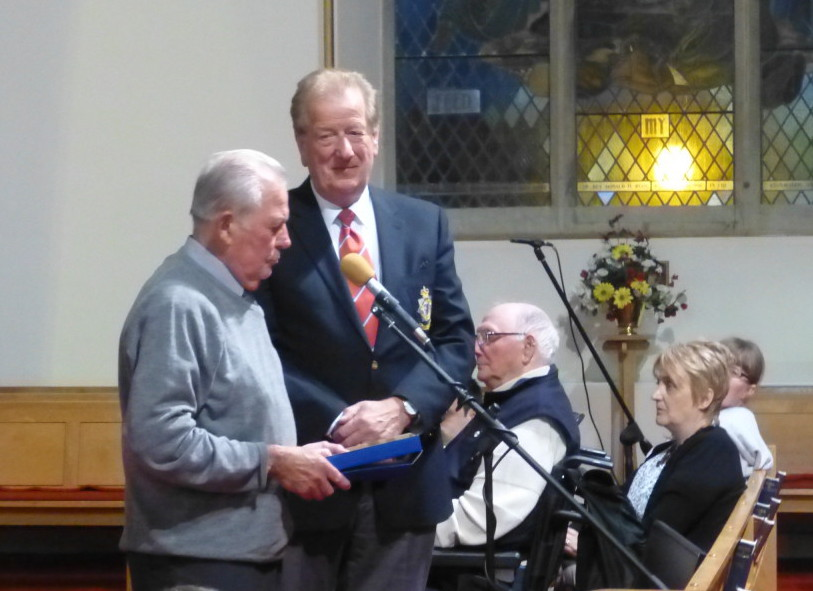 Raymond Bartley presents Denbigh Town Council plaque to Rod Dean, Chairman of Avon and Somerset Constabulary MVC