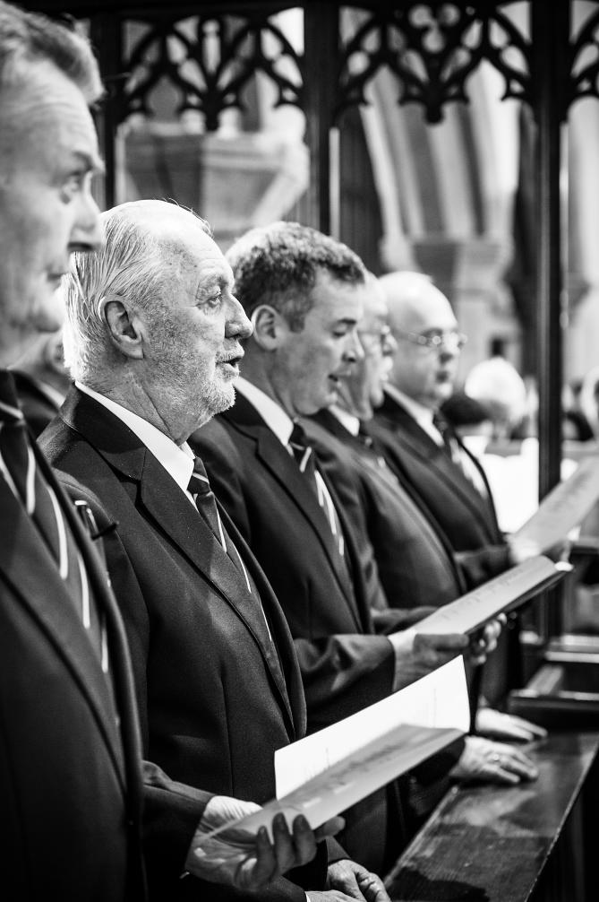 Gordon Price, second left, singing with Choir